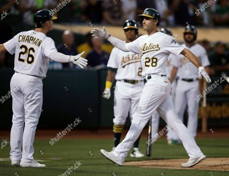 Matt Olson, Matt Chapman. Oakland Athletics' Matt Olson, right, celebrates with Matt Chapman (26) after hitting a three-run home run off Houston Astros' Aaron Sanchez during the fourth inning of a baseball game, in Oakland, Calif