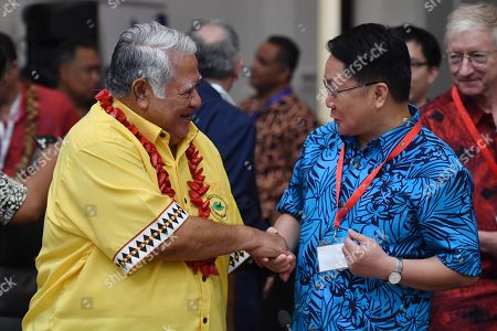 Stock Photo of Samoa's Prime Minister Tuilaepa Aiono Sailele Malielegaoi (L) and China's Special Envoy for the Pacific Islands Forum Wang Xuefeng (R) greet each other at the Forum Dialogue Partners Meeting during the Pacific Islands Forum in Funafuti, Tuvalu, 16 August 2019.