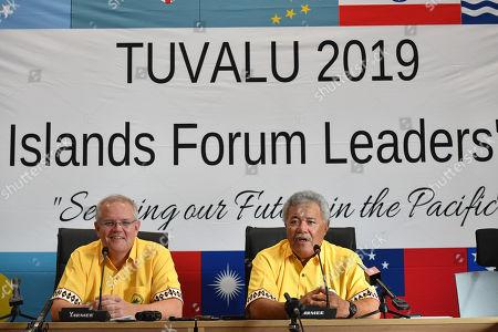 Stock Photo of Australia's Prime Minister Scott Morrison (L) and Tuvalu's Prime Minister Enele Sopoaga (R) participate in a press conference during the Pacific Islands Forum in Funafuti, Tuvalu, 16 August 2019.