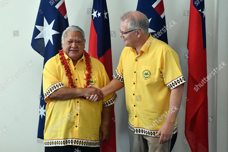 Samoa's Prime Minister Tuilaepa Aiono Sailele Malielegaoi (L) greets Australia's Prime Minister Scott Morrison (R) for a bilateral meeting during the Pacific Islands Forum in Funafuti, Tuvalu, 16 August 2019.