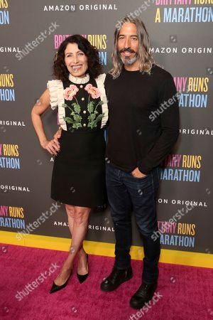 "Lisa Edelstein, Robert Russell. Lisa Edelstein, left, and Robert Russell attend the LA Premiere of ""Brittany Runs a Marathon"" at th Regal LA Live & 4DX, in Los Angeles"