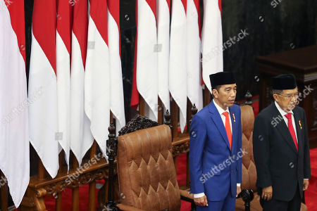 Indonesian President Joko Widodo (L) accompanied by his Vice President Jusuf Kalla (R) sings the national anthem shortly before delivering his annual address at the Parliament building in Jakarta, Indonesia, 16 August 2019. Indonesia will celebrate its Independence Day on 17 August.