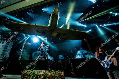 Bruce Dickinson;Steve Harris. Bruce Dickinson, left, and Steve Harris of Iron Maiden perform at the Riverbend Music Center, in Cincinatti, OH