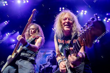 Steve Harris;Janick Gers. Steve Harris, left, and Janick Gers of Iron Maiden perform at the Riverbend Music Center, in Cincinatti, OH