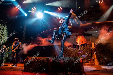 Bruce Dickinson; Adrian Smith; Dave Murray. Dave Murray, from left, Adrian Smith, and Bruce Dickinson of Iron Maiden perform at the Riverbend Music Center, in Cincinatti, OH