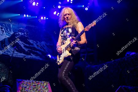 Janick Gers of Iron Maiden performs at the Riverbend Music Center, in Cincinatti, OH