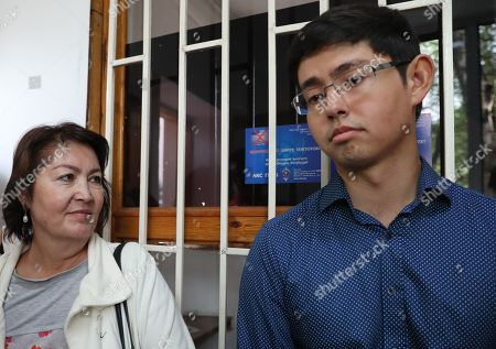 The wife of the former president of Kyrgyzstan  Raisa Atambaeva (L), and son  Kadyr Atambayev (R) at the building of the National Security Committee of Kyrgyzstan, in Bishkek, Kyrgyzstan, 16 August 2019. The Bishkek city court considerd the appeal of ex-president Almazbek Atambayev against his arrest. The court decided to leave the ex-president of the country Almazbek Atambayev in custody in the GKNB pre-trial detention center until 26 August 2019.