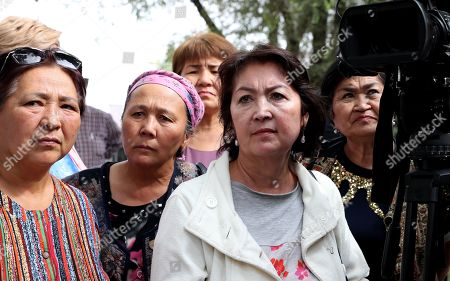 The wife of the former president of Kyrgyzstan Raisa Atambaeva (C) near the building of the National Security Committee of Kyrgyzstan, in Bishkek, Kyrgyzstan, 16 August 2019. The Bishkek city court considerd the appeal of ex-president Almazbek Atambayev against his arrest. The court decided to leave the ex-president of the country Almazbek Atambayev in custody in the GKNB pre-trial detention center until 26 August 2019.