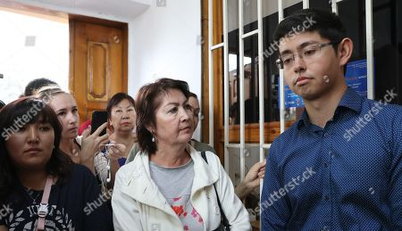The wife of the former president of Kyrgyzstan  Raisa Atambaeva (C), and son  Kadyr Atambayev (R) at the building of the National Security Committee of Kyrgyzstan, in Bishkek, Kyrgyzstan, 16 August 2019. The Bishkek city court considerd the appeal of ex-president Almazbek Atambayev against his arrest. The court decided to leave the ex-president of the country Almazbek Atambayev in custody in the GKNB pre-trial detention center until 26 August 2019.