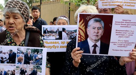 Stock Photo of Kyrgyz women with posters reading 'Light power bends but does not break,' 'Atambaev is always with the people,' 'A pure heart always bears good' during a Bishkek rally in Kyrgyzstan, 16 August 2019. The court decided to leave the ex-president of the country Almazbek Atambayev in custody in the GKNB pre-trial detention center until 26 August 2019.