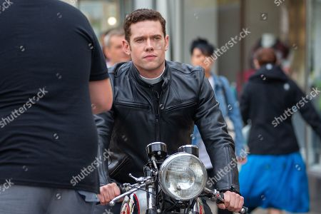 Stock Photo of Tom Brittney filming in Cambridge for the ITV drama Grantchester