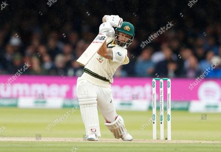 Australia's Matthew Wade plays a shot off the bowling of England's Stuart Broad on day three of the 2nd Ashes Test cricket match between England and Australia at Lord's cricket ground in London