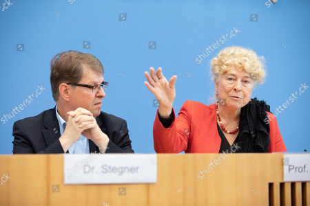 Stock Photo of Deputy Chairman of the German Social Democratic Party (SPD) Ralf Stegner (L) and Gesine Schwan, chairwoman of the German Social Democratic Party (SPD) core-values commission (R) during a press conference at the Federal Press Conference in Berlin, Germany, 16 August, 2019. The two politicians presented their joint candidacy for the SPD leadership. Since the resignation of former SPD leader Andrea Nahles and low support rates in several local and federal election campaigns in the country, some voices from with in the party note that the SPD will need a double headed leadership to handle its challenges.