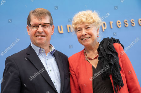 Stock Image of Deputy Chairman of the German Social Democratic Party (SPD) Ralf Stegner (L) and Gesine Schwan, chairwoman of the German Social Democratic Party (SPD) core-values commission (R) pose for a photo after a press conference at the Federal Press Conference in Berlin, Germany, 16 August, 2019. The two politicians presented their joint candidacy for the SPD leadership. Since the resignation of former SPD leader Andrea Nahles and low support rates in several local and federal election campaigns in the country, some voices from with in the party note that the SPD will need a double headed leadership to handle its challenges.