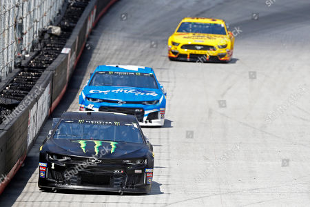 Driver Kurt Busch (1) leads Kyle Larson (42) and Michael McDowell down the back straight during practice for a NASCAR Cup Series auto race, in Bristol, Tenn