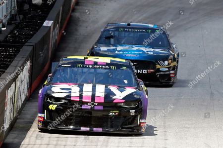 Driver Jimmie Johnson (48) leads Clint Bowyer down the back straight during practice for a NASCAR Cup Series auto race, in Bristol, Tenn