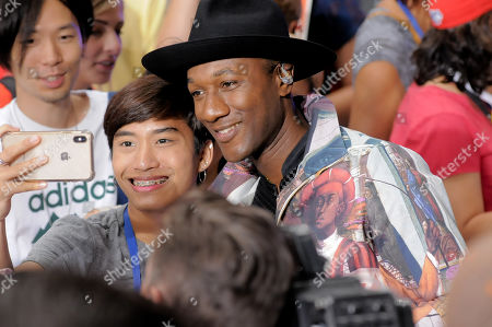 Stock Picture of Aloe Blacc takes a selfie with fan after his performance at Rockefeller Center in New York City