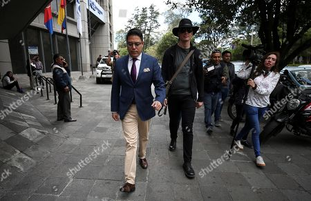 Swedish computer expert Ola Bini (R) and lawyer Carlos Soria (L) arrive at the Attorney's Office, in Quito, Ecuador, 16 August 2019. Bini, friend of Julian Assange is under investigation for alleged espionage. Ecuador Attorney's Office has ordered the analysis of his smartphone.