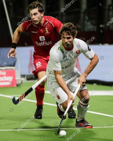Pau Quemada of Spain (ft) and Cedric Charlier (bk) of Belgium fight for the ball during the EuroHockey 2019 men match between Belgium and Spain in Antwerp, Belgium, 16 August 2019.