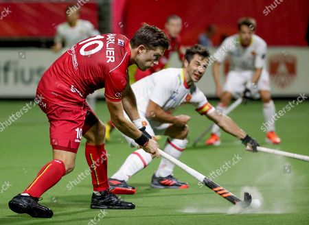 Cedric Charlier (L) of Belgium fights for the ball with Miquel Delas of Spain during the EuroHockey 2019 men match between Belgium and Spain in Antwerp, Belgium, 16 August 2019.