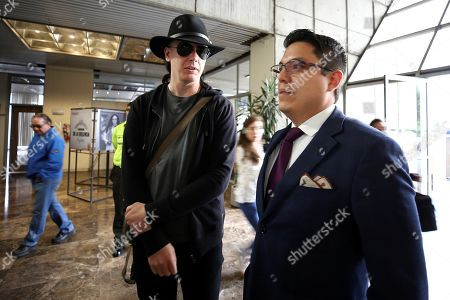 Swedish computer expert Ola Bini (L) and lawyer Carlos Soria (R) arrive at the General Attorney's office, in Quito, Ecuador, 16 August 2019. Bini, friend of Julian Assange is under investigation for alleged espionage. Ecuador's General Attorney's office has ordered the analysis of his smartphone.