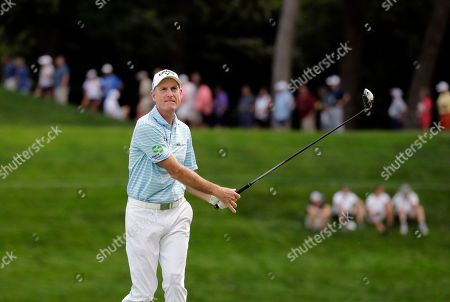 Stock Picture of Jim Furyk reacts as he watches his tee shot on the 18th hole during the second round of the BMW Championship golf tournament at Medinah Country Club, in Medinah, Ill