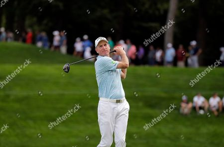 Jim Furyk watches his tee shot on the 18th hole during the second round of the BMW Championship golf tournament at Medinah Country Club, in Medinah, Ill