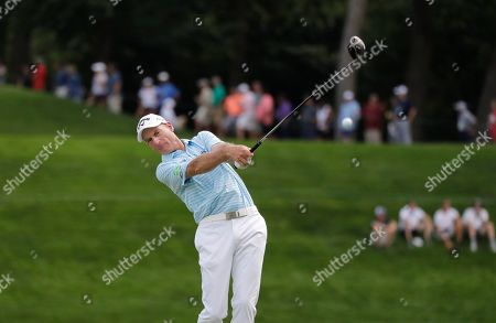 Stock Photo of Jim Furyk hits his tee shot on the 18th hole during the second round of the BMW Championship golf tournament at Medinah Country Club, in Medinah, Ill