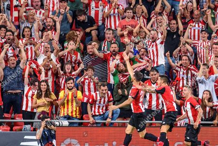 Athletic Bilbao's striker Aritz Aduriz (L) celebrates after scoring against FC Barcelona during a Spanish LaLiga soccer match between Athletic Bilbao and FC Barcelona at the San Mames stadium in Bilbao, Spain, 16 August 2019.