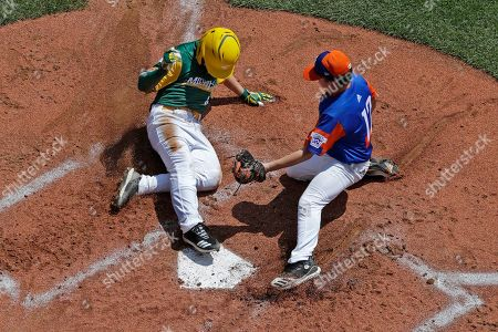 Tyler Phillips, Grayson Newman. Coon Rapids, Minnesota's Tyler Phillips, left, scores ahead of the tag-attempt by Bowling Green, Kentucky's Grayson Newman during the second inning of a baseball game at the Little League World Series tournament in South Williamsport, Pa