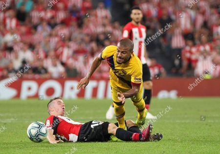 Rafinha of Barcelona and Iker Muniain of Athletic Bilbao