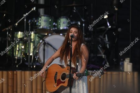 Stock Image of Cassidy Daniels performs as the warmup act to Billy Currington during a summer concert held at The Freeman Stage in Selbyville, DE