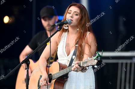 Cassidy Daniels performs as the warmup act to Billy Currington during a summer concert held at The Freeman Stage in Selbyville, DE