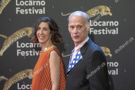 John Waters, right, with artistic Director Filmfestival Locarno, Lili Hinstin, left, a the red carpet at the Piazza Grande at the 72th Locarno International Film Festival in Locarno, Switzerland, 16 August 2019. The Festival del film Locarno runs from 07 to 17 August 2019.