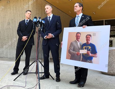 Matt Murphy, Todd Spitzer. Newport Beach Police Sgt. Ryan Peters, left, Senior Deputy District Attorney Matt Murphy and District Attorney Todd Spitzer, right, talk to the media following guilty verdicts for Hossein Nayeri in Newport Beach, Calif., . Peters was the lead detective in the case. Spitzer is holding a photo of himself presenting a $100,000 check to Matthew Hay-Chapman after Hay-Chapman spotted Nayeri in San Francisco after breaking out of jail. Nayeri was found guilty of masterminding and carrying out the abduction and sexual mutilation of a Newport Beach marijuana dispensary owner