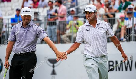 Hideki Matsuyama of Japan (R) gets a hand slap from Ryan Palmer of the US (L) after sinking a birdie putt on the eighteenth green during the second round of the BMW Championship at Medinah Country Club in Medinah, Illinois, USA, 16 August 2019. The BMW Championship is the second of three playoff tournaments to determine the FedEx Cup champion.