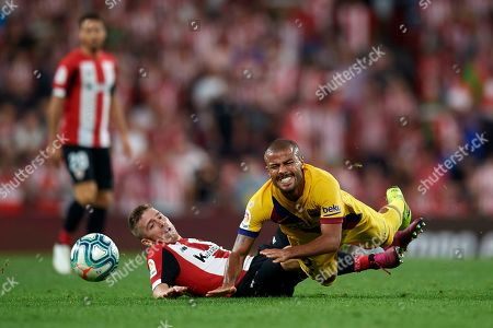 Rafinha of Barcelona and Iker Muniain of Athletic battle for the ball