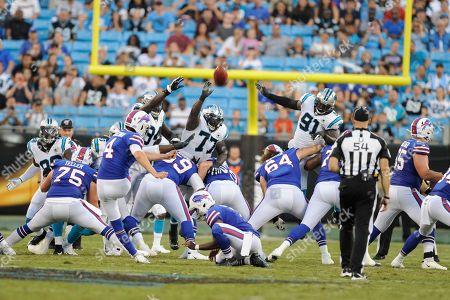 Carolina Panthers defens against Buffalo Bills kicker Stephen Hauschka (4) during the first half an NFL preseason football game, in Charlotte, N.C