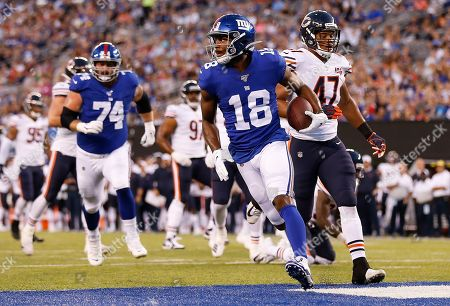 New York Giants wide receiver Bennie Fowler (18) crosses the goal line to score a touchdown against the Chicago Bears during the first quarter of a preseason NFL football game, in East Rutherford, N.J