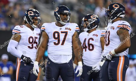 Chicago Bears defensive end Roy Robertson-Harris (95), defensive tackle Nick Williams (97), linebacker James Vaughters (46) and defensive end Jonathan Bullard (90) wait during a break in play against the New York Giants during the second quarter of a preseason NFL football game, in East Rutherford, N.J