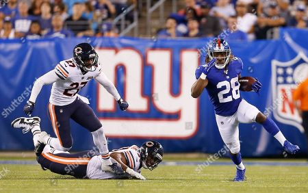 Stock Image of New York Giants running back Paul Perkins (28) runs the ball against the Chicago Bears during the second quarter of a preseason NFL football game, in East Rutherford, N.J