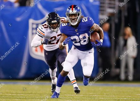 Stock Picture of New York Giants running back Paul Perkins (28) runs the ball against the Chicago Bears during the second quarter of a preseason NFL football game, in East Rutherford, N.J