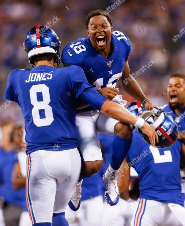 New York Giants wide receiver Bennie Fowler (18) and quarterback Daniel Jones (8) celebrate after a touchdown against the Chicago Bears during the second quarter of a preseason NFL football game, in East Rutherford, N.J