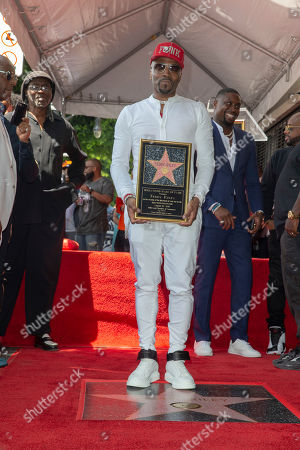US Artist/music producer Teddy Riley kneels in front of his star during a star ceremony honoring him with the 2,670th star on the Hollywood Walk of Fame in Hollywood, California, USA, 16 August 2019. The star was dedicated in the Category of Recording.