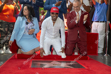 US Artist/music producer Teddy Riley (c) kneels down in front of his star with Hollywood Chamber of Commerce President Rana Ghadban (L) and city councilman Mitch Oâ??Farrell (R) during a star ceremony honoring recording artist/music producer Teddy Riley for the 2,670th star on the Hollywood Walk of Fame in Hollywood, California, USA, 16 August 2019. The star was dedicated in the Category of Recording.