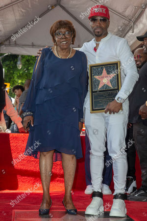 US Artist/music producer Teddy Riley(R) and is mother Mildred Riley (L) pose in front of his star during a star ceremony honoring him with the 2,670th star on the Hollywood Walk of Fame in Hollywood, California, USA, 16 August 2019. The star was dedicated in the Category of Recording.