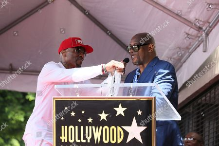 Stock Picture of US Recording artist/music producer Teddy Riley (L) helps executive producer Andre Harrell (R) with the microphone during a star ceremony honoring Teddy Riley for the 2,670th star on the Hollywood Walk of Fame in Hollywood, California, USA, 16 August 2019. The star was dedicated in the Category of Recording.