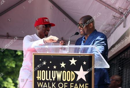 US Recording artist/music producer Teddy Riley (L) helps executive producer Andre Harrell (R) with the microphone during a star ceremony honoring Teddy Riley for the 2,670th star on the Hollywood Walk of Fame in Hollywood, California, USA, 16 August 2019. The star was dedicated in the Category of Recording.