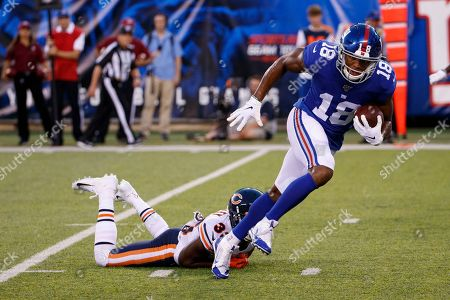 , 2019, New York Giants wide receiver Bennie Fowler (18) slips past Chicago Bears cornerback Duke Shelley (33) on his way to a touchdown during the NFL preseason game between the Chicago Bears and the New York Giants at MetLife Stadium in East Rutherford, New Jersey