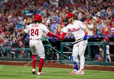 Philadelphia Phillies' Roman Quinn (24) celebrates with Bryce Harper after hitting a home run off of San Diego Padres' Chris Paddack during the third inning of a baseball game, in Philadelphia
